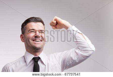 Happy Man Exulting Raising His Arm