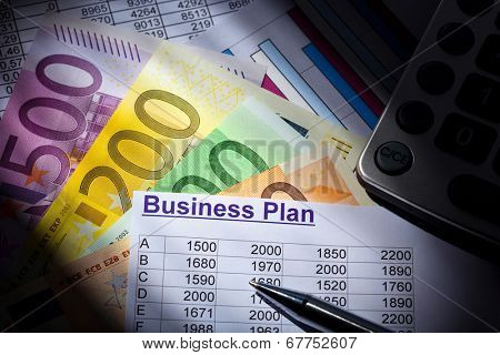 a business plan for starting a business. ideas and strategies for self-employment. euro banknotes and calculator