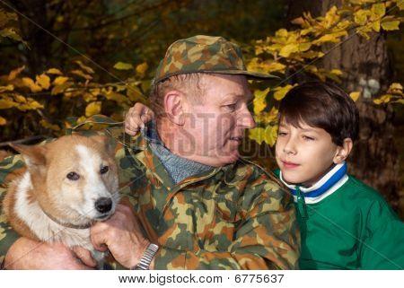 Grandfather, Grandson And Dog