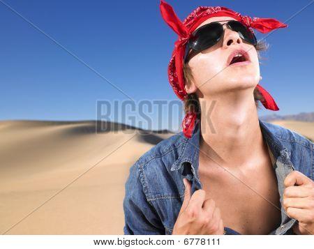 Young Man Wearing Sunglasses And Bandana Opening Shirt