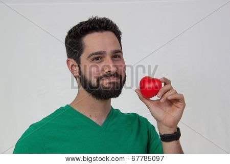 bearded young man holding heart