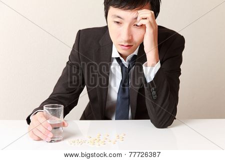 middle aged Japanese businessman suffers from a neurosis