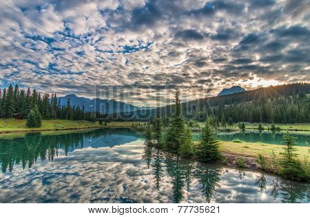 Amazing Clouds And Trees Reflected In Lake