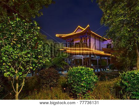 Chinese Building In Park At Night