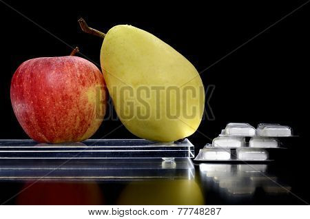 Pear And Apple On A Tray And Medicine