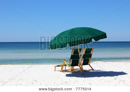 Two Chairs And Umbrella On White Sand Beach