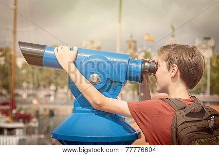 teenage boy with rucksack looking through a sightseeing monocular poster