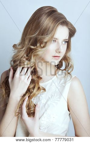 Tender young woman with long curtly blond hair poster