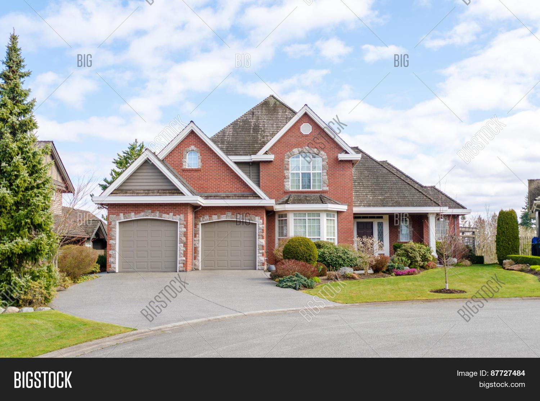 Luxury brick house two car garage image photo bigstock for Brick garages prices