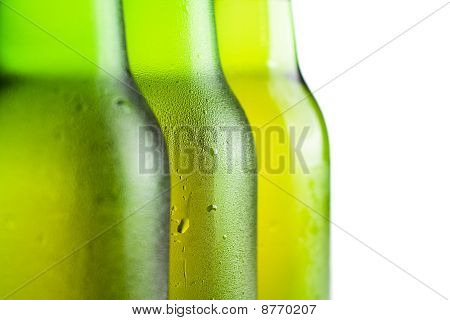 Three Green Beer Bottles Over White Background