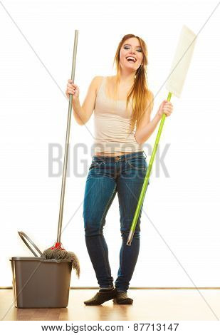 Cleanup housework concept. Funny cleaning girl young woman mopping floor holding two mops new and old white background poster