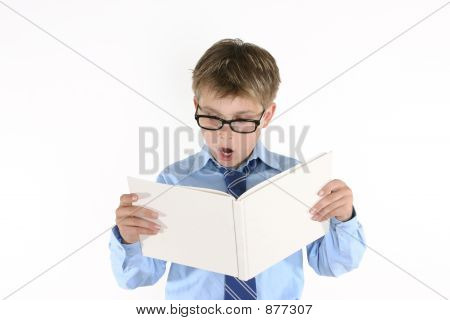 Child Student Reading A Book