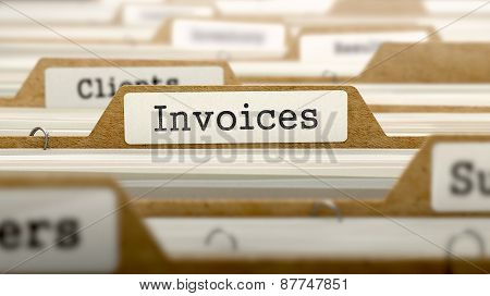 Invoices Concept with Word on Folder.