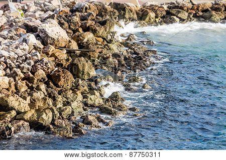 Drain Pipe In Stone Seawall