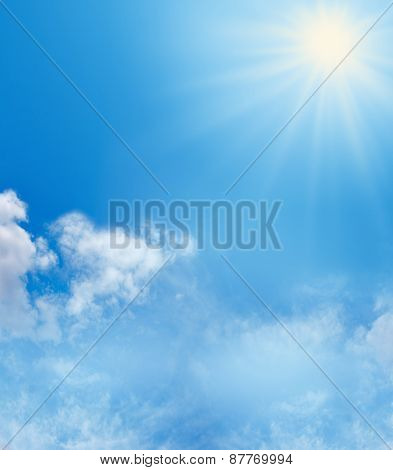 Blue Sky, Fluffy Clouds and Sunshine Holiday Background