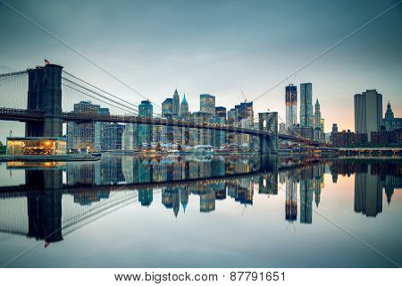Brooklyn bridge and Manhattan at dusk, New York City
