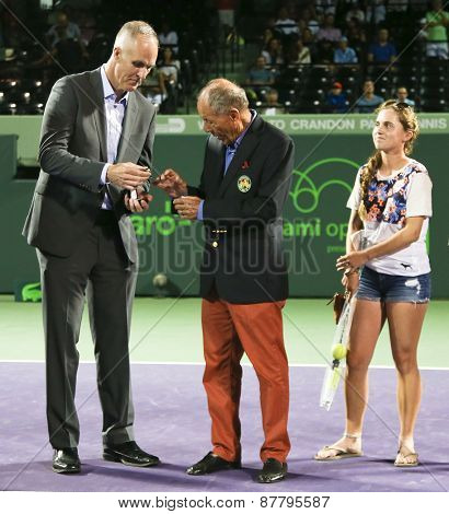 KEY BISCAYNE, FL-MAR 26: Tennis coach Nick Bollettieri (C)receives his International Tennis Hall of Fame ring from Todd Martin (L) at Crandon Park on March 26, 2015 in Key Biscayne, Florida.