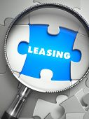 Leasing through Lens on Missing Puzzle Peace. Selective Focus. 3D Render. poster