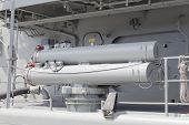 Deck-mounted torpedo launchers on a modern destroyer poster