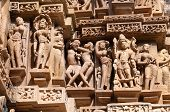 Stone carved erotic sculptures on Lakshmana temple. Western temples of Khajuraho. Madhya Pradesh. India. Built around 999 poster