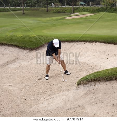 Hiing The Ball On Sand