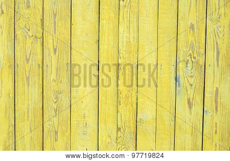 Grungy wood planks wall texture with yellow peeling paint