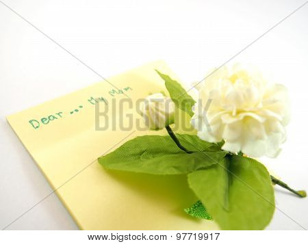 Dear My Mom On Empty Sticky Note For Being Card With Blurred Handmade White Jasmin Flower, Mother's