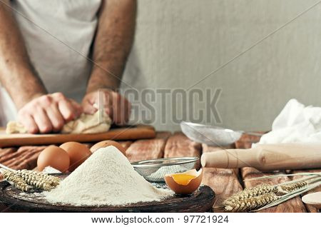 A Handful Of Flour With Egg On A Rustic Kitchen
