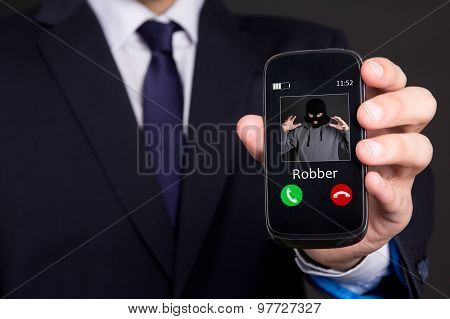 Phone Robbery Concept - Hand Holding Smart Phone With Incoming Call From Robber