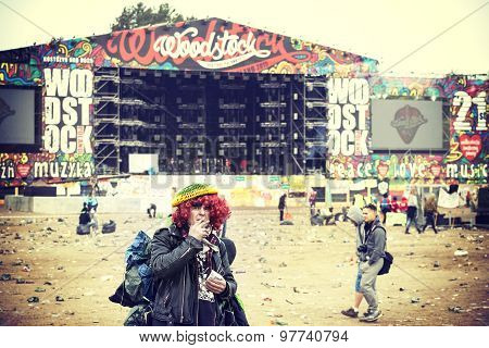 Woodstock Fan Standing In Front Of Main Stage.