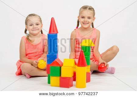 Happy Two Girls Built A Castle Out Of Blocks