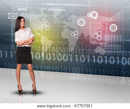 Businesslady looking at camera with crossed arms