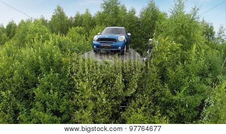 RUSSIA, NICOLA-LENIVETS - JUL 5, 2014: Mini cooper near people in Wonderland Park during 9th International Festival of landscape objects Archstoyanie. Aerial view (Photo with noise from action camera)
