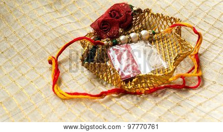 Rakhi Thread In Gold Holder With Tika & Rice
