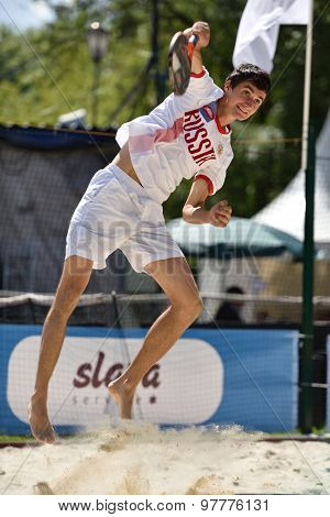 MOSCOW, RUSSIA - JULY 16, 2015: Nikita Burmakin of Russia in the match of the ITF Beach Tennis World Team Championship against Greece. Russia won 3-0