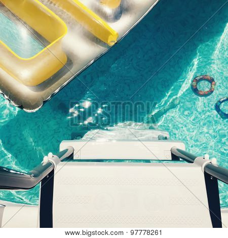 Overhead Birdseye View Of Backyard Swimming Pool With Toys