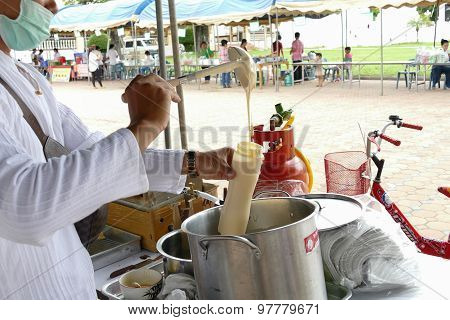 The Man Is Pouring Batter For Making Thailand Traditional Egg Cake