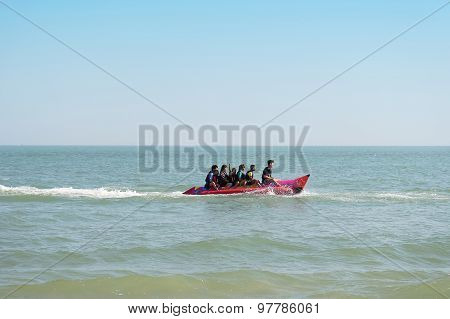 Tourists Enjoying Ride Banana Boat Adventure