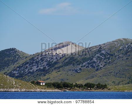 Houses in the rough landscape of the island Kornat