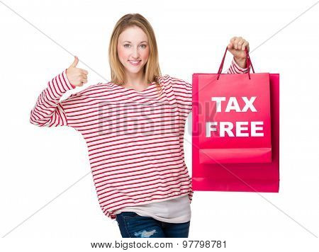 Woman hand thumb up gesture and hold with shopping bag showing tax free