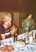 Vintage photo (scanned reversal film) of two woman during family dinner, early 1970's poster