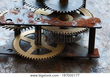 Heavy machinery transmission technology, iron wheels gears connected system. Old rusted mechanism, different type of cogs teeth on aged metallic background.