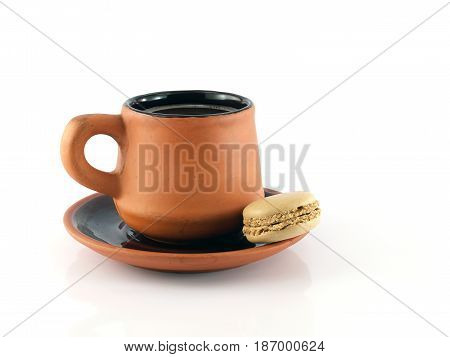 coffee cup and saucer with macaron (macaroon) isolated on white background, cup of coffee and saucer made of baked clay