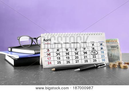 Calendar and notebooks on table