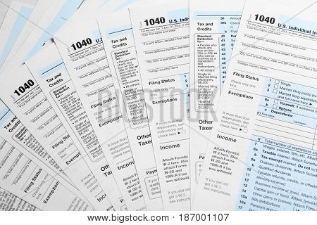 Individual Tax Return Forms on table