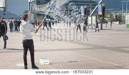 Man Makes Giant Bubbles In The Middle Of A Central Square