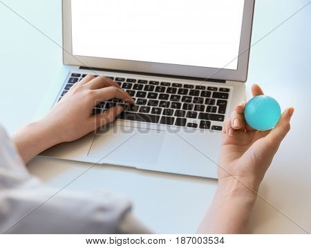 Woman training with rubber ball at work space