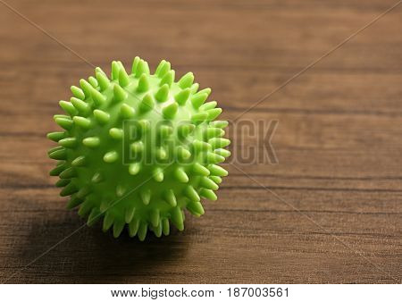 Rubber ball on wooden background
