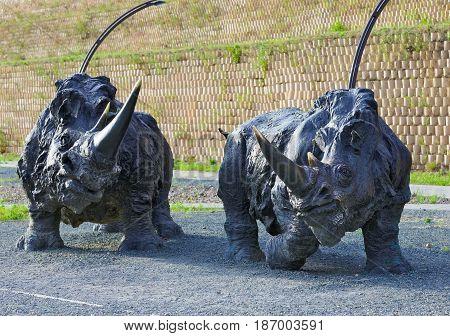 Editorial.Khanty-Mansiysk Yugra Russia August 12 2012 Archeopark Samarovo town The sculptural composition Woolly rhinoceroses