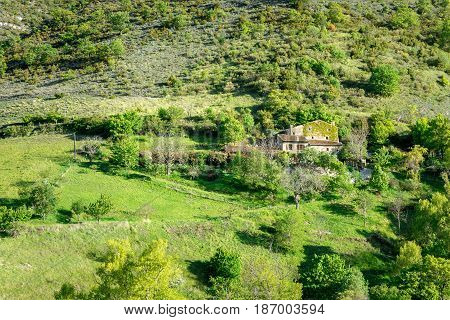 French countryside. Green landscape of the Vercors with typical stone house.